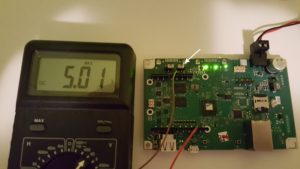 Switching the jumper (white arrow) changes the I/O voltage. The jumper just to the left of it disables VIN.