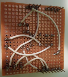The finished shield (bottom), still missing a power wire. Can you spot the missing solder joints?